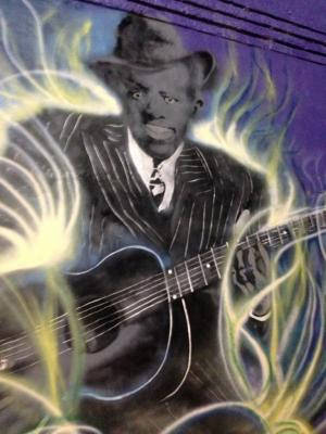 mural of Robert Johnson at the crossroads